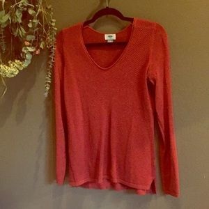 Vneck sweater in a rusty red color
